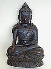 A carved wood image depicting  Sakyamuni Buddha