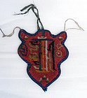 Yak headpiece with Kalacakra symbol.