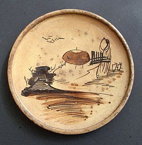 Plate of Seto ware decorated with a stylized landscape