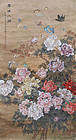A decorative scroll painting with butterflies & peonies