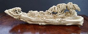 Great carved ivory landscape-boat shape. Ca 1900