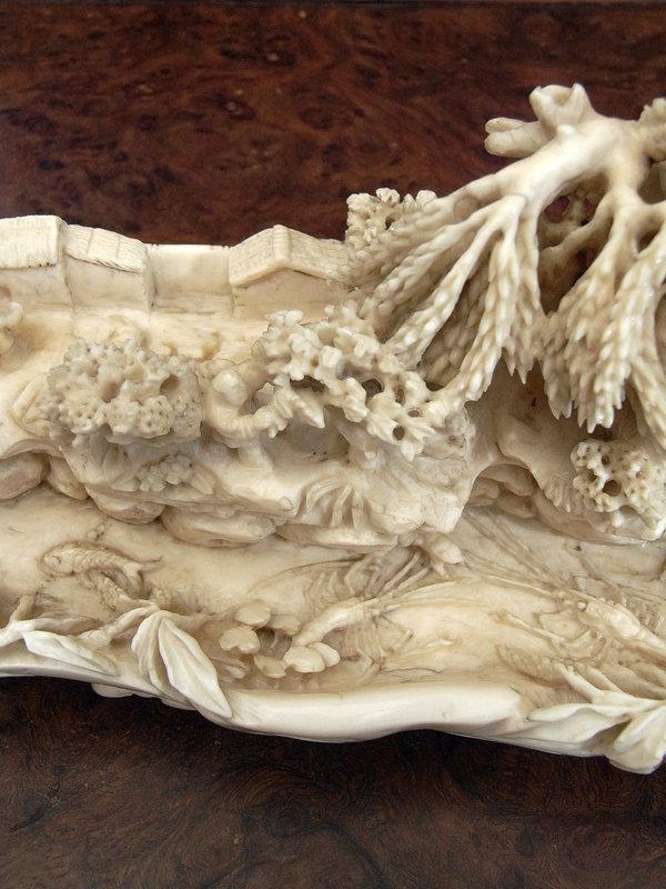 Great carved ivory landscape-boat shape. Ca 1900