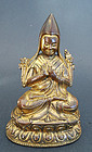A fire gilt bronze portrait-image of Tsongkapa; Tibet, 17th cent.
