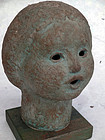A charming, sculpted head of a small girl. By Heima Gaku (b. 1931)
