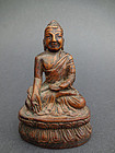 A wood carving depicting the Medicine Buddha. Early 19th cent.