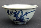 Small porcelain bowl decorated with stylised orchids. Ming/early Qing