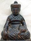 Small carved image of a Lama, Karma-Kagyupa