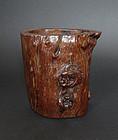 A natural hardwood brush pot (bitong) for the scholar's table.