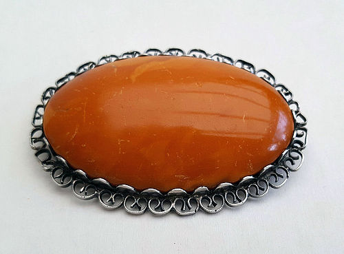 Great Large Antique Brooch of Amber with Silver mounting. 15 gr.