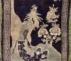 A Vintage Baotou carpet with Phoenix design