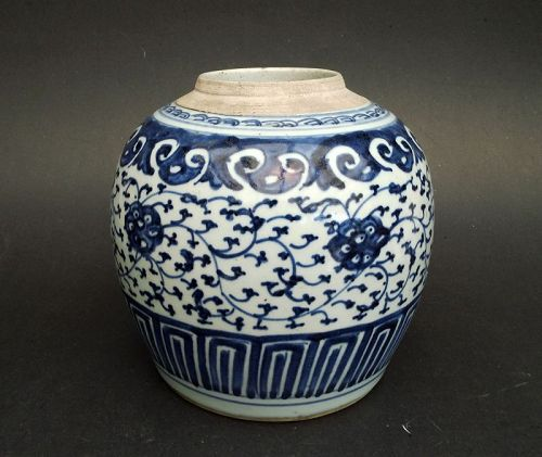 A blue & white jar decorated with stylised flower scrolls. Qing