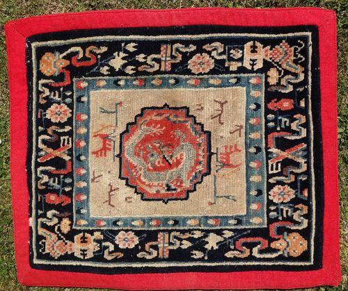Antique Tibetan Meditation Rug with Dragon and Buddhist Symbols