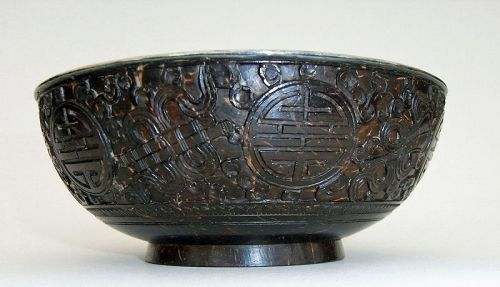 Antique Finely Carved Pair of Coconut Bowls with silver insert.