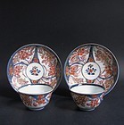 A pair of Imari Hydrangea pattern Tea bowls and Saucers Early 18th C.