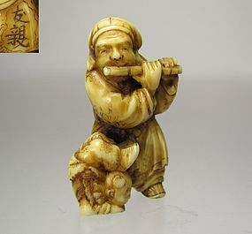 TOMOCHIKA, 19th Century Japanese Netsuke:  Daikoku and the Acrobat