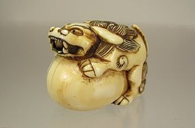 Early 19th Century Japanese Netsuke:  Shishi on a Ball