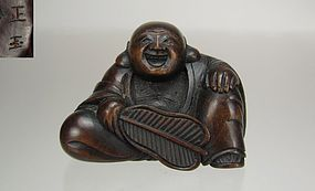 SHOGYOKU, 19th Century Japanese Boxwood Netsuke: Hotei with Fan