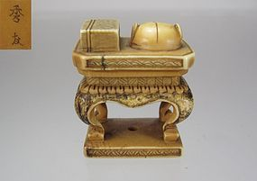 Hidetomo, Early 19th C., Japanese Netsuke, Stand with Book and Hat