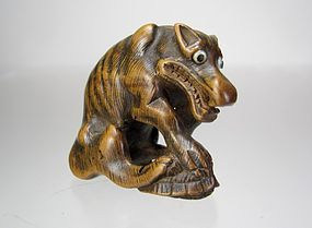 TOMOMASA, 19th C. Japanese Boxwood Netsuke: Wolf over Minogame