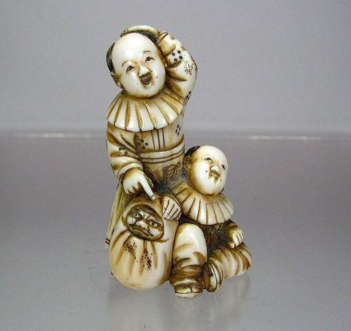 19th Century Japanese Netsuke:  Two Karakos with Daruma Doll