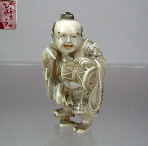 YOSHIYUKI, 19th C. Japanese Netsuke:  Entertainer Playing  Hand Drum