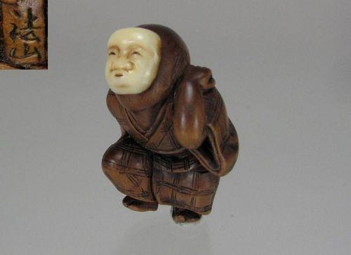 HOZAN, 1800's, Japanese Mixed Materials Netsuke: Entertainer