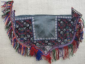 A vintage Turkmen Tekke silk embroidered child's bib