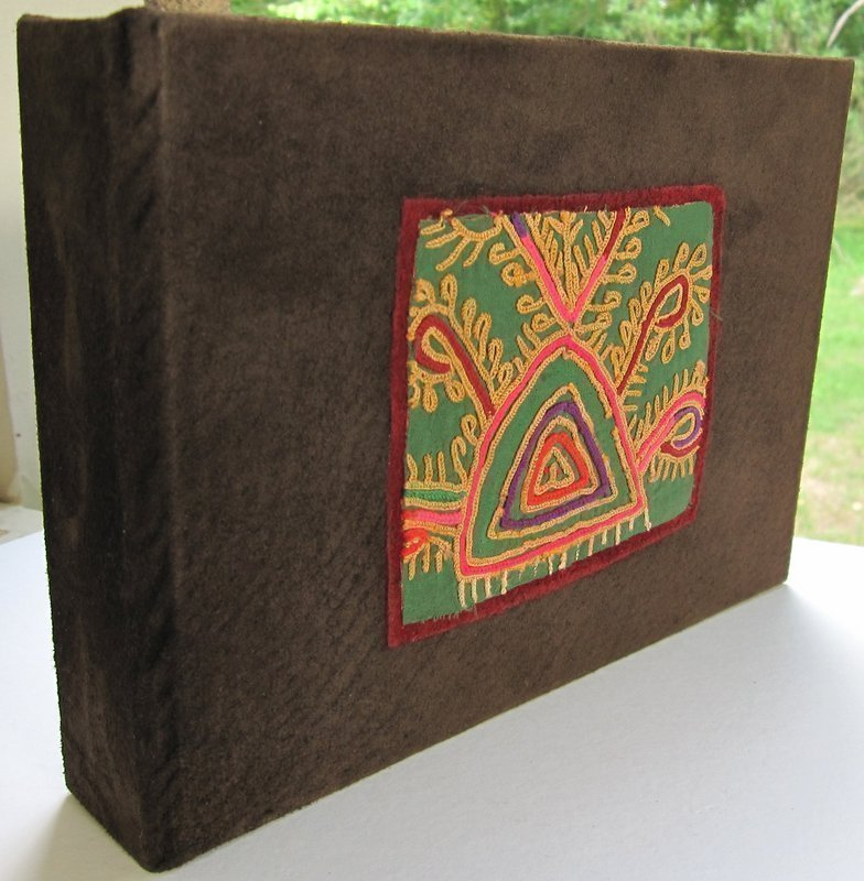 A photo album featuring Afghan embroidery