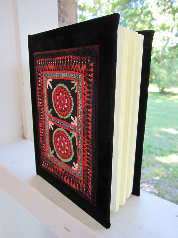 A handmade suede journal with Afghan embroidery