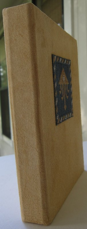 A handmade suede journal with Uzbek embroidery