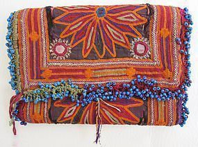 A vintage trifold wallet from Afghanistan w/ blue beads