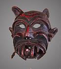 Old primitive mask of a demon, Himalaya, Nepal