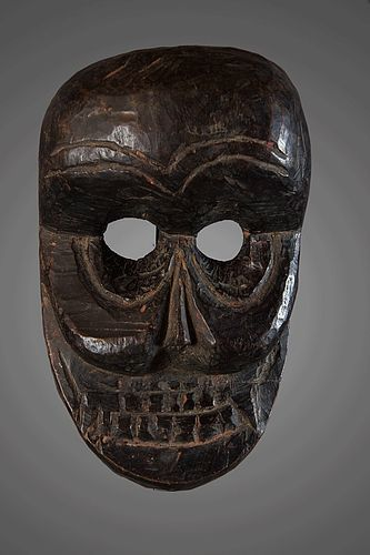 Black patina skull mask, India, Himalaya
