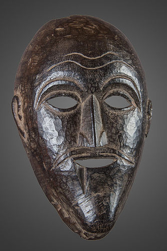 Old black patina mask from East Nepal, Himalaya