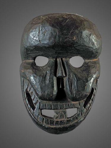 Black skull mask , Himalaya , india, Nepal