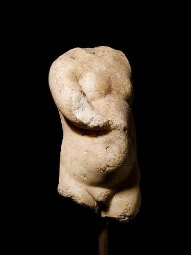 A ROMAN MARBLE TORSO OF AN INFANT, Circa 3rd Century A.D.