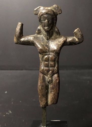 An etruscan bronze handle in a form of a kouros, 5th century