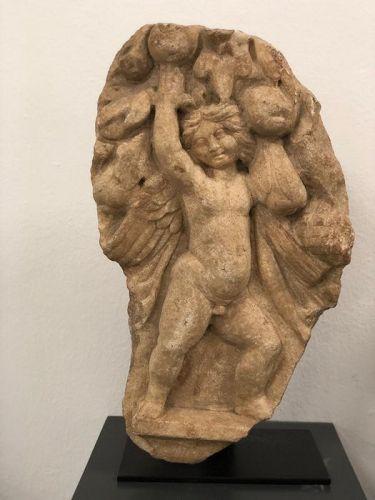 Roman Marble sarcophagus fragment depicting Eros, 2nd-3rd Century A.D