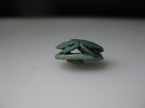 An Egyptian Faience Undercut Scarab With A Protective Motto