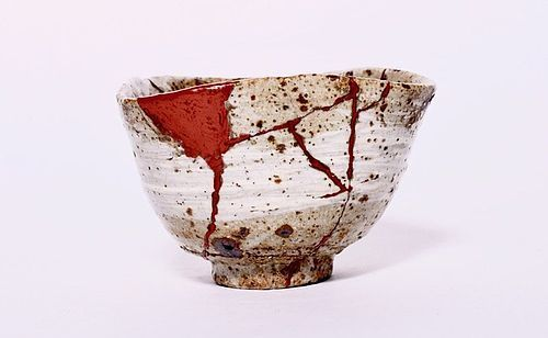 An Old Hakeme Karatsu Tea Bowl with Red Lacquer Repairs