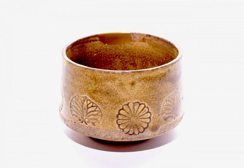 A Beautiful Edo Period ki-Seto Tea Bowl with Gold and Silver Repairs