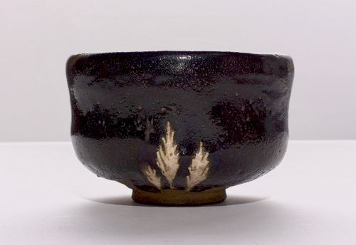 A Black Raku Tea Bowl with Pine Bough Design