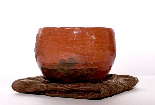 A Red Raku Tea Bowl by Dohachi II (Ninami)