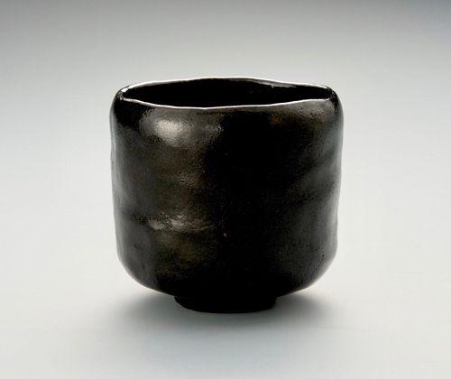 A Black Raku Tea Bowl by Ito Tozan