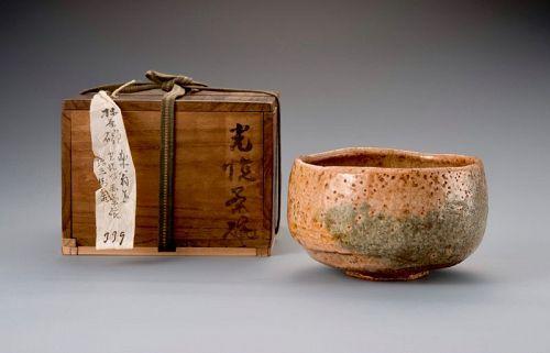 A Rare Tamamizu Red Raku Tea Bowl with Gold Repairs