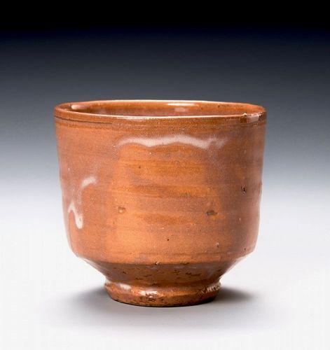 An Antique Red Raku Tsu-Tsu Tea Bowl