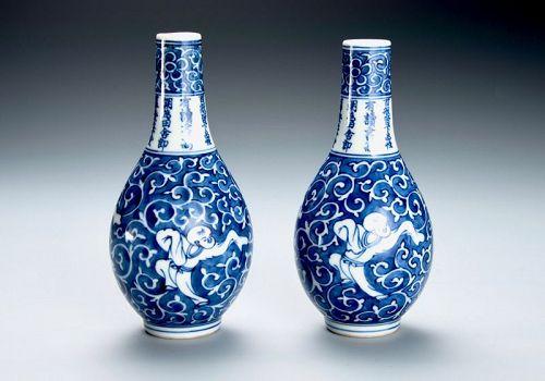 A Set of Eiraku Porcelain Saké Flasks with Painted Karako