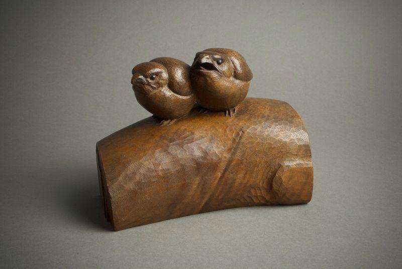 A Japanese wood okimono of two chicks by Ohno Meizan