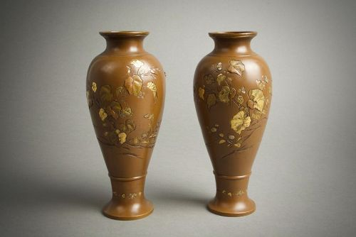 A Japanese pair of mixed metal vases