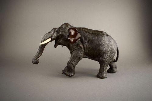 A Japanese bronze okimono of an elephant